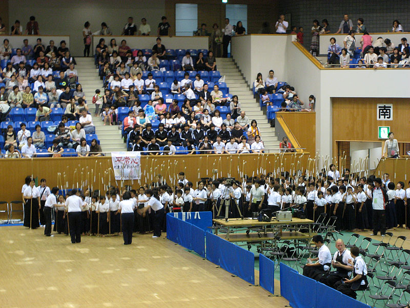 children waiting to perform a naginata demonstration
